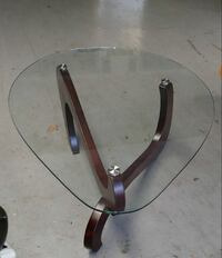 triangular glass-top brown wooden base table