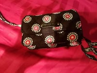 woman's black white and pink floral sling bag Virginia Beach, 23464