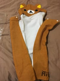 brown and white zip-up hoodie 559 km