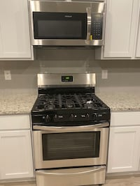 Brand new Frigidaire gas range and microwave