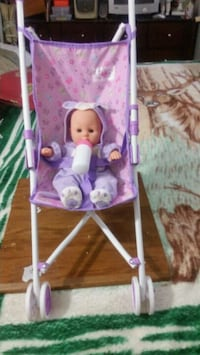 baby's pink and white swing chair Houston, 77047