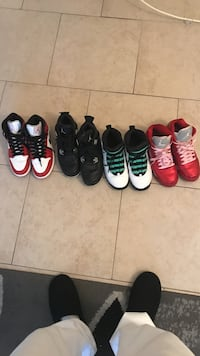 Four pairs of assorted-colored air jordan basketball shoes
