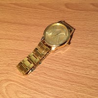 round gold analog watch with gold link bracelet Côte-Saint-Luc, H4W 1A5