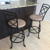 Two black metal framed brown padded bar stools Toronto, M4P 1T4