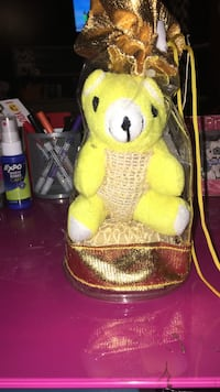 yellow animal plush toy in plastic pack
