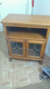 brown wooden framed glass cabinet Mansfield