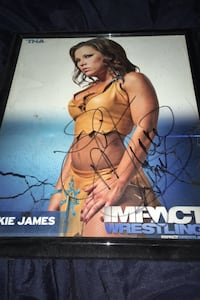 Autograph picture of pro wrestler Mickie