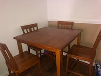 rectangular brown wooden table with four chairs dining set Houston, 77036