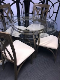 Round glass top table with four chairs dining set St Catharines, L2P 1Z2