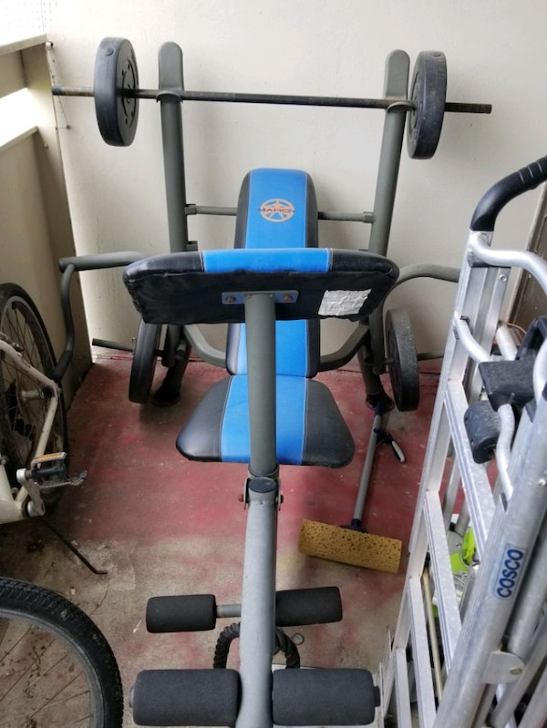 black and blue exercise equipment 26f08343-d537-48a3-8fde-587172b3d3bc