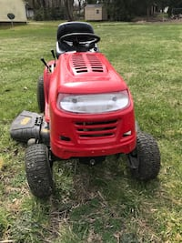 red and black ride-on mower