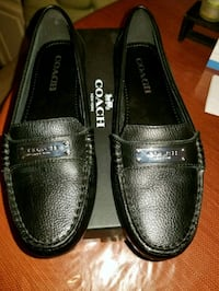 pair of black leather loafers Jersey City, 07306