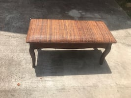 Brown wooden wicker bench