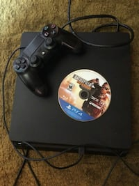 black Sony PS4 console with controller and game disc West Hollywood, 90048