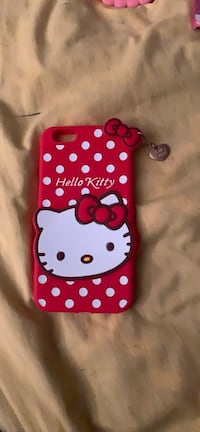 Red and white hello kitty with charm