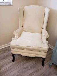 Traditional winged backed chair