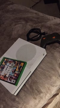 Xbox 360 console with controller and game case