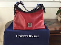 Red leather Dooney and Bourke  like new  with dust bag Riverside, 92501