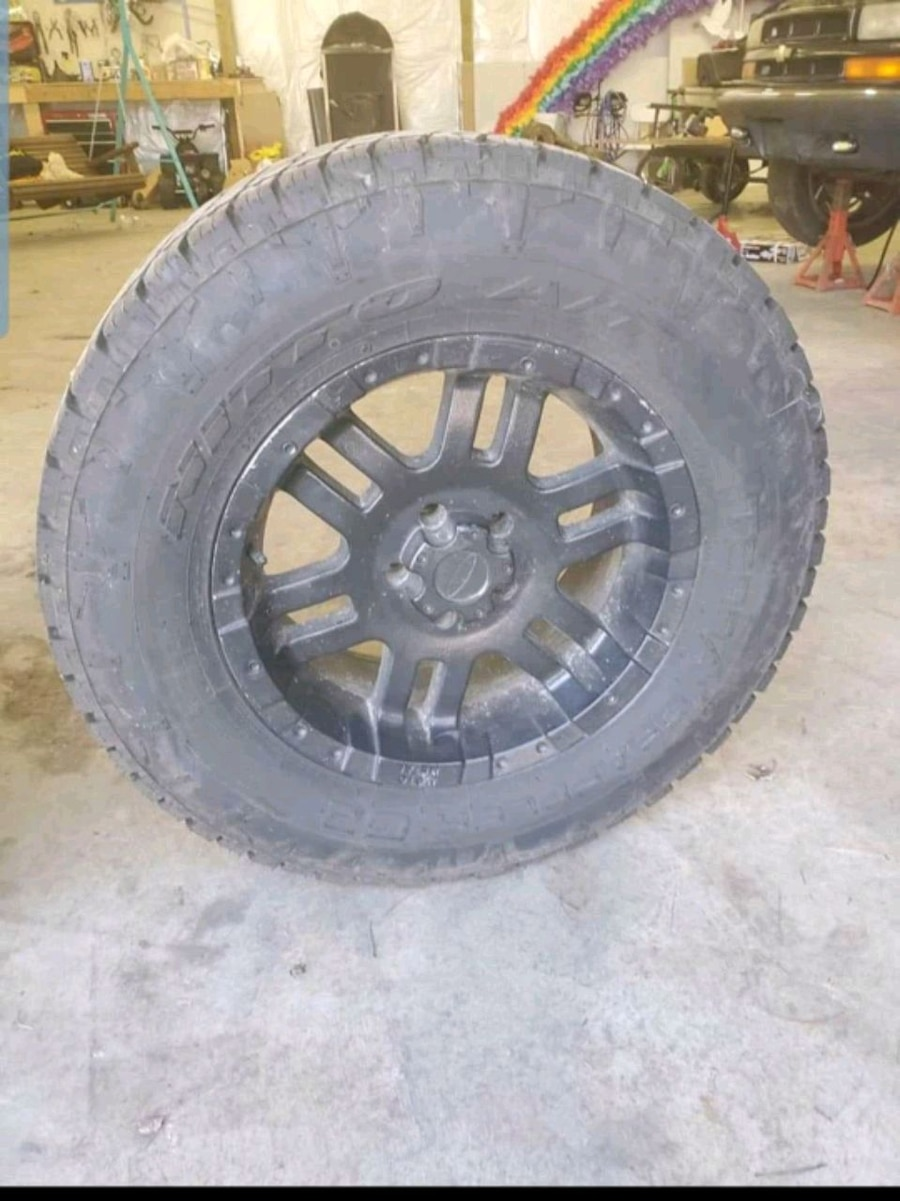 Photo Set of 5 tires and rims.Came off 07 jeep wrangler Bolt pattern 5x5