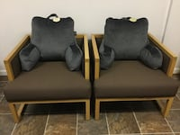 Two oak designer entertainment chairs just like NEW! Come with two brand new back cushions. Burnaby