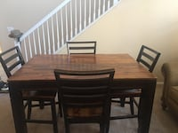 rectangular brown wooden table with four chairs dining set Moreno Valley, 92555