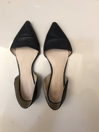 Pair of black pointed-toe heeled shoes Hong Kong