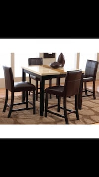 rectangular brown wooden table with four chairs dining set Breaux Bridge, 70517