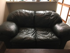 Green leather loveseat with single seater and ottoman