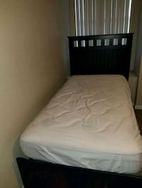 white mattress with black wooden bed frame Las Vegas, 89113