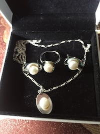 silver-colored and white pearl pendant necklace with earrings and ring