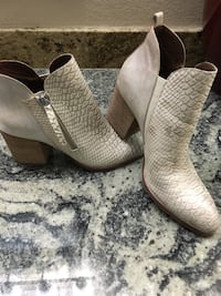 pair of brown leather booties Peoria