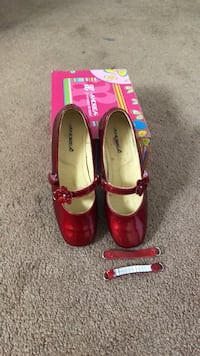 pair of red leather pointed-toe heels ONTARIO