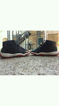 pair of black Air Jordan 11's Houston, 77060