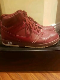pair of red Nike basketball shoes 551 km