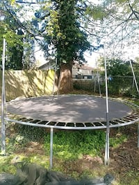 Full size Trampoline with upper safety net.