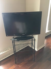 black flat screen TV with remote Oakville, L6L 0S9