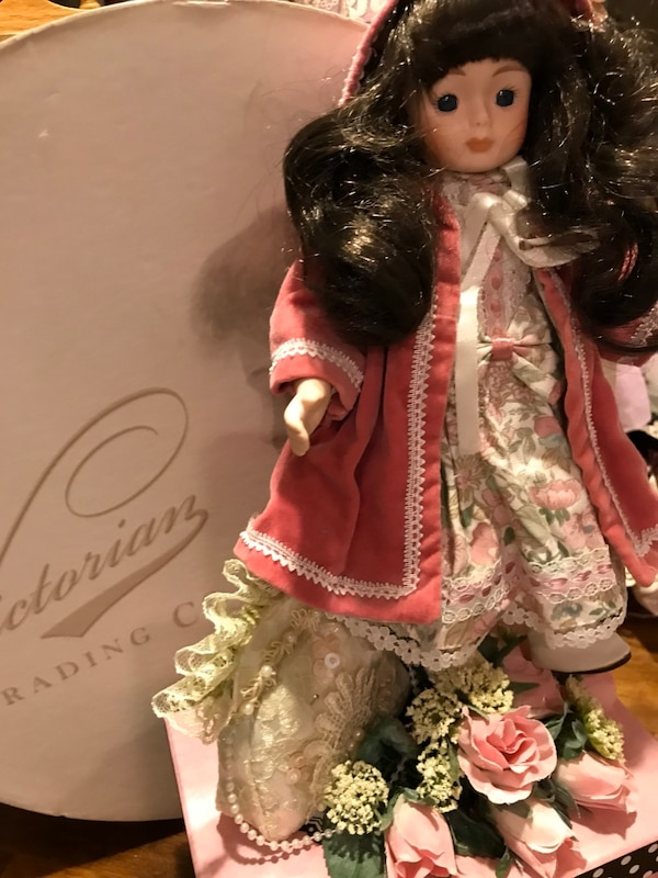 Pretty Victorian Small Porcelain Doll with long Dark hair