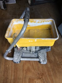 Gray and yellow metal-based paint sprayer