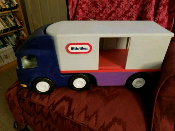 blue and white Little Tikes toy truck