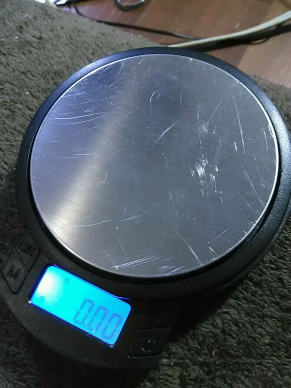 round black and gray plastic container