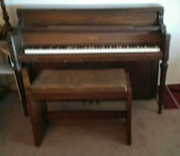 brown wooden frame upright piano
