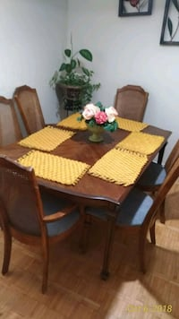 rectangular brown wooden table with six chairs din Mississauga
