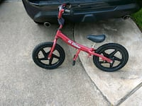 toddler's pink and black bicycle Tomball, 77375
