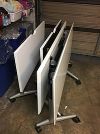 4 folding tables with casters  San Diego, 92104
