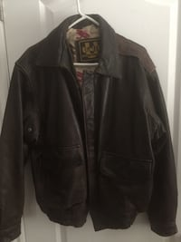 Brown leather zip-up jacket.  Never been worn, won in a Xmas party raffle last year, doesn't fit me.