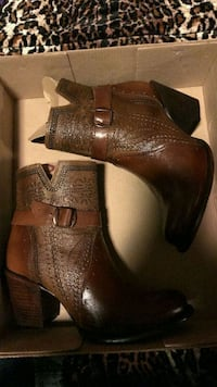 pair of brown leather heeled boots Houston
