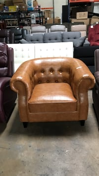 Brown leather tufted sofa chair