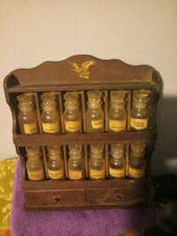 Old antique spice bottles and rack