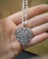 silver necklace with heart shaped pendant