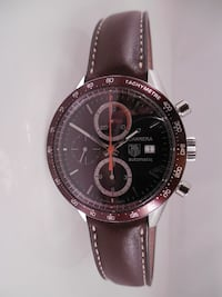 round Tag Heuer with brown leather strap
